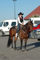 Murphy-and-Montana-Dasher-Snap-getting-ready-to-run-barrels-at-the-11-CNFR.